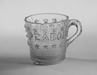 Unknown. <em>Mug (George Peabody)</em>, late 19th century. Glass, 2 1/2 x 2 1/2 x 2 1/2 in. (6.4 x 6.4 x 6.4 cm). Brooklyn Museum, Gift of Mrs. William Greig Walker by subscription, 40.188. Creative Commons-BY (Photo: Brooklyn Museum, 40.188_bw.jpg)