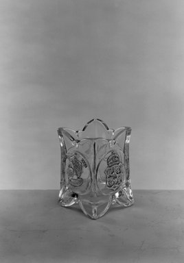<em>Toothpick Holder (Amerigo Vespucci & Christopher Columbus)</em>, ca. 1892. Glass, 2 7/8 x 2 x 2 in. (7.3 x 5.1 x 5.1 cm). Brooklyn Museum, Gift of Mrs. William Greig Walker by subscription, 40.189. Creative Commons-BY (Photo: Brooklyn Museum, 40.189_acetate_bw.jpg)