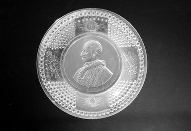 <em>Plate (Pope Leo XIII)</em>, ca. 1893. Glass, 1 1/4 x 9 7/8 x 9 7/8 in. (3.2 x 25.1 x 25.1 cm). Brooklyn Museum, Gift of Mrs. William Greig Walker by subscription, 40.192. Creative Commons-BY (Photo: Brooklyn Museum, 40.192_bw.jpg)