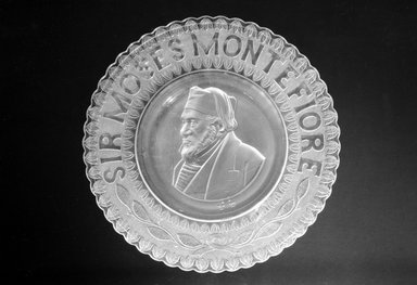 <em>Plate (Sir Moses Montefiore)</em>, ca. 1885. Glass, 1 1/4 x 10 1/2 x 10 1/2 in. (3.2 x 26.7 x 26.7 cm). Brooklyn Museum, Gift of Mrs. William Greig Walker by subscription, 40.193. Creative Commons-BY (Photo: Brooklyn Museum, 40.193_bw.jpg)
