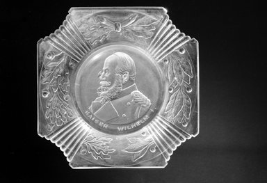 <em>Plate (Kaiser Wilhelm I)</em>, ca. 1888. Glass, 1 1/4 x 9 7/8 x 9 7/8 in. (3.2 x 25.1 x 25.1 cm). Brooklyn Museum, Gift of Mrs. William Greig Walker by subscription, 40.194. Creative Commons-BY (Photo: Brooklyn Museum, 40.194_bw.jpg)
