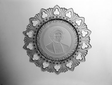 <em>Plate (Christopher Columbus)</em>, ca. 1892. Glass, 1 1/4 x 9 3/4 x 9 3/4 in. (3.2 x 24.8 x 24.8 cm). Brooklyn Museum, Gift of Mrs. William Greig Walker by subscription, 40.196. Creative Commons-BY (Photo: Brooklyn Museum, 40.196_bw.jpg)