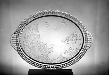 Crystal Glass Company (Bridgeport, Ohio). <em>Platter (Alaskan scene)</em>, 1867. Glass, 1 1/4 x 15 1/2 x 11 1/8 in. (3.2 x 39.4 x 28.3 cm). Brooklyn Museum, Gift of Mrs. William Greig Walker by subscription, 40.208. Creative Commons-BY (Photo: Brooklyn Museum, 40.208_acetate_bw.jpg)