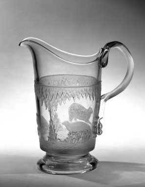 Crystal Glass Company (Bridgeport, Ohio). <em>Pitcher (Alaskan scene)</em>, 1867. Glass, 9 3/4 x 8 3/4 x 5 in. (24.8 x 22.2 x 12.7 cm). Brooklyn Museum, Gift of Mrs. William Greig Walker by subscription, 40.209a. Creative Commons-BY (Photo: Brooklyn Museum, 40.209a_bw.jpg)