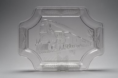 American. <em>Platter (Train with Engine #350)</em>, ca. 1885. Glass, 1 x 12 x 8 7/8 in. (2.5 x 30.5 x 22.5 cm). Brooklyn Museum, Gift of Mrs. William Greig Walker by subscription, 40.210. Creative Commons-BY (Photo: Brooklyn Museum, 40.210.jpg)