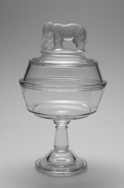 "Canton Glass Company (American, (1883-after 1999)). <em>Bowl and Lid, ""Jumbo"" pattern</em>, 1882. Glass, 12 x 7 1/8 x 7 1/8 in. (30.5 x 18.1 x 18.1 cm). Brooklyn Museum, Gift of Mrs. William Greig Walker by subscription, 40.225a-b. Creative Commons-BY (Photo: Brooklyn Museum, 40.225a-b.jpg)"