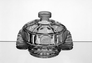 American. <em>Butter Dish and Lid</em>, 1892. Glass, 4 5/8 x 6 1/2 x 6 1/2 in. (11.7 x 16.5 x 16.5 cm). Brooklyn Museum, Gift of Mrs. William Greig Walker by subscription, 40.235a-b. Creative Commons-BY (Photo: Brooklyn Museum, 40.235_acetate_bw.jpg)