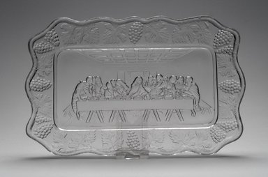 American. <em>Plate (Leonardo DaVinci's Last Supper)</em>, late 19th century. Glass, 1 x 10 7/8 x 7 in. (2.5 x 27.6 x 17.8 cm). Brooklyn Museum, Gift of Mrs. William Greig Walker by subscription, 40.237. Creative Commons-BY (Photo: Brooklyn Museum, 40.237.jpg)