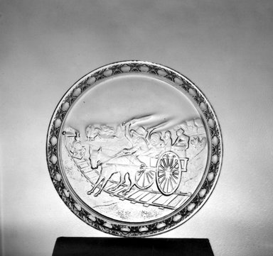 American. <em>Plate (Railroad Crossing scene)</em>, late 19th century. Glass, 3/4 x 9 1/2 x 9 1/2 in. (1.9 x 24.1 x 24.1 cm). Brooklyn Museum, Gift of Mrs. William Greig Walker by subscription, 40.239. Creative Commons-BY (Photo: Brooklyn Museum, 40.239_acetate_bw.jpg)