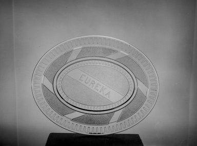 American. <em>Platter (Eureka / Gold Rush)</em>, 1849. Glass, 11 1/4 x 8 7/8 in. (28.6 x 22.5 cm). Brooklyn Museum, Gift of Mrs. William Greig Walker by subscription, 40.258. Creative Commons-BY (Photo: Brooklyn Museum, 40.258_acetate_bw.jpg)