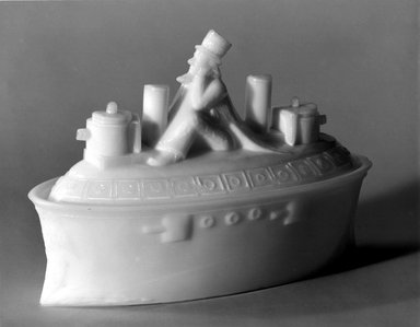 American. <em>Covered Dish, Battleship with Uncle Sam</em>, 1880. Glass, 4 3/4 x 3 x 6 5/8 in. (12.1 x 7.6 x 16.8 cm). Brooklyn Museum, Gift of Mrs. William Greig Walker by subscription, 40.261a-b. Creative Commons-BY (Photo: Brooklyn Museum, 40.261_bw.jpg)
