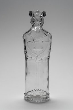 American. <em>Bottle, Figure of George Washington</em>, late 19th century. Glass, 9 1/2 x 3 1/8 x 2 3/4 in. (24.1 x 7.9 x 7 cm). Brooklyn Museum, Gift of Mrs. William Greig Walker by subscription, 40.275. Creative Commons-BY (Photo: Brooklyn Museum, 40.275.jpg)