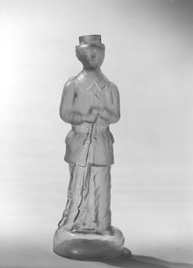 American. <em>Bottle, Figure of French Soldier</em>, late 19th century. Glass, 11 1/2 x 3 3/4 x 3 3/4 in. (29.2 x 9.5 x 9.5 cm). Brooklyn Museum, Gift of Mrs. William Greig Walker by subscription, 40.280. Creative Commons-BY (Photo: Brooklyn Museum, 40.280_bw.jpg)