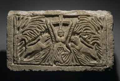 Coptic. <em>The Martyrdom of St. Thekla</em>, 6th century C.E., perhaps with modern reworking. Limestone, pigment, 13 3/16 x 23 1/4 x 5 5/16 in. (33.5 x 59 x 13.5 cm). Brooklyn Museum, Charles Edwin Wilbour Fund, 40.299. Creative Commons-BY (Photo: Brooklyn Museum, 40.299_PS2.jpg)