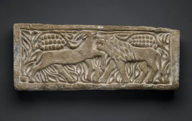 Coptic. <em>Lion Attacking an Antelope</em>, 6th century C.E.; modern reworking. Limestone, 8 11/16 x 21 7/16 x 2 3/8 in. (22 x 54.5 x 6 cm). Brooklyn Museum, Charles Edwin Wilbour Fund, 40.302. Creative Commons-BY (Photo: Brooklyn Museum, 40.302_PS1.jpg)