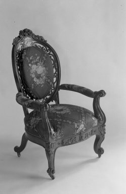 Attributed to Charles H. White. <em>Armchair</em>, ca. 1855. Rosewood, modern upholstery (reupholstered April 1958), 43 x 26 1/2 x 21 1/2 in. (109.2 x 67.3 x 54.6 cm). Brooklyn Museum, Gift of Louise G. Zabriskie, 40.351.6. Creative Commons-BY (Photo: Brooklyn Museum, 40.351.6_after_treatment_acetate_bw.jpg)
