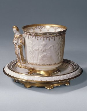 "Union Porcelain Works (1863-ca. 1922). <em>""Liberty"" Cup and Saucer</em>, ca. 1876. Porcelain, (a) Cup: 3 7/8 x 3 3/4 x 3 3/4 in. (9.8 x 9.5 x 9.5 cm). Brooklyn Museum, Gift of Mrs. Luke Vincent Lockwood, 40.374a-b. Creative Commons-BY (Photo: Brooklyn Museum, 40.374a-b_SL1.jpg)"