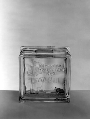 American. <em>Bank (New York World's Fair)</em>, 1940. Glass, 1 3/4 x 3 1/4 x 3 1/4 in. (4.4 x 8.3 x 8.3 cm). Brooklyn Museum, Gift of Mrs. William Greig Walker, 40.376. Creative Commons-BY (Photo: Brooklyn Museum, 40.376_acetate_bw.jpg)