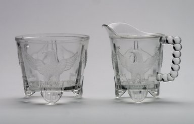American. <em>Cream Pitcher or Creamer</em>, ca. 1898. Glass, 4 1/2 x 5 1/4 x 3 3/8 in. (11.4 x 13.3 x 8.6 cm). Brooklyn Museum, Gift of Mrs. V. B. Howe, 40.377.2. Creative Commons-BY (Photo: , 40.377.1_40.377.2.jpg)