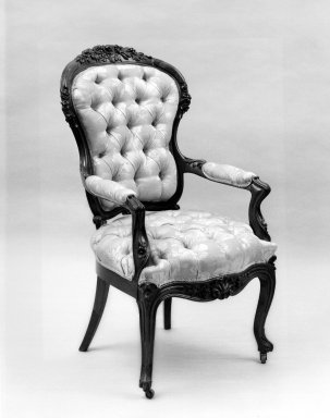 Elijah Galusha (American, ca. 1850). <em>Open Armchair (Rococo Revival style)</em>, 1856. Rosewood, modern upholstery, 41 1/2 x 22 x 21 in. (105.4 x 55.9 x 53.3 cm). Brooklyn Museum, Dick S. Ramsay Fund, 40.589. Creative Commons-BY (Photo: Brooklyn Museum, 40.589_print_bw_SL1.jpg)