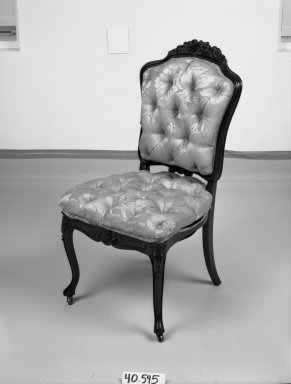 Elijah Galusha (American, ca. 1850). <em>Side chair (one of a set of four)</em>, 1856. Rosewood, modern upholstery, 35 1/4 x 18 x 17 3/8 in. (89.5 x 45.7 x 44.1 cm). Brooklyn Museum, Dick S. Ramsay Fund, 40.595. Creative Commons-BY (Photo: Brooklyn Museum, 40.595_bw_IMLS.jpg)