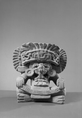 Zapotec. <em>Funerary Urn in Form of Seated Figure</em>. Gray clay, 10 1/2 x 8 x 5 3/4 in. Brooklyn Museum, Ella C. Woodward Memorial Fund, 40.713. Creative Commons-BY (Photo: Brooklyn Museum, 40.713_acetate_bw.jpg)