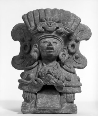 Zapotec. <em>Funerary Urn in Form of Seated Figure</em>, ca. 200-700. Gray clay, 10 1/2 × 8 1/4 × 5 3/8 in. (26.7 × 21 × 13.7 cm). Brooklyn Museum, Ella C. Woodward Memorial Fund, 40.714. Creative Commons-BY (Photo: Brooklyn Museum, 40.714_bw.jpg)