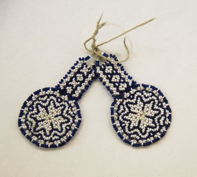 Huichol (Wixárika). <em>Pair of Earrings</em>. Cotton, beads, a: 1 5/16 x 2 1/4 in. (3.3 x 5.7 cm). Brooklyn Museum, Ella C. Woodward Memorial Fund, 40.729a-b. Creative Commons-BY (Photo: Brooklyn Museum, 40.729a-b_front_PS5.jpg)