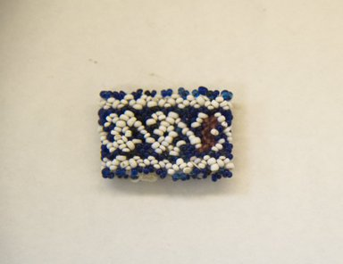 Huichol (Wixárika). <em>Ring</em>. Cotton, beads, 3/4 x 1 1/8 in. (1.9 x 2.9 cm). Brooklyn Museum, Ella C. Woodward Memorial Fund, 40.736. Creative Commons-BY (Photo: Brooklyn Museum, 40.736_front_PS5.jpg)