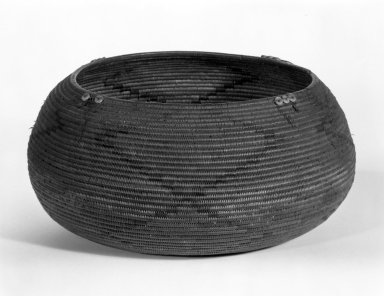 Mission Indians. <em>Coiled Basket</em>. Fiber, feathers, shell, 6 7/8 x 4 15/16 in.  (17.5 x 12.5 cm). Brooklyn Museum, Gift of D.D. Streeter, 40.770. Creative Commons-BY (Photo: Brooklyn Museum, 40.770_view1_bw.jpg)