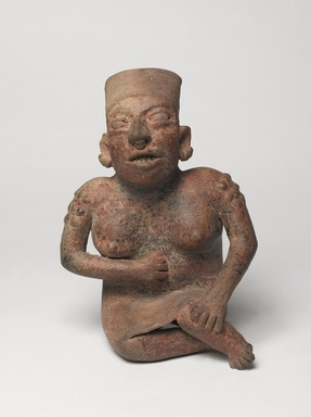 Jalisco. <em>Seated Figure of a Woman</em>, 300 BCE-300 CE. Ceramic, pigment, 10 × 6 1/2 × 5 3/4 in. (25.4 × 16.5 × 14.6 cm). Brooklyn Museum, Ella C. Woodward Memorial Fund, 40.919. Creative Commons-BY (Photo: , 40.919_overall_PS9.jpg)
