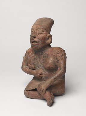 Jalisco. <em>Seated Figure of a Woman</em>, 300 BCE-300 CE. Ceramic, pigment, 10 × 6 1/2 × 5 3/4 in. (25.4 × 16.5 × 14.6 cm). Brooklyn Museum, Ella C. Woodward Memorial Fund, 40.919. Creative Commons-BY (Photo: , 40.919_threequarter_left_PS9.jpg)