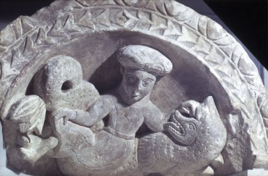 Coptic. <em>Top of an Arch with a Nymph Riding a Sea Monster</em>, 5th-6th century C.E. Limestone, pigment, 18 1/8 x 31 1/8 x 14 3/8 in. (46 x 79 x 36.5 cm). Brooklyn Museum, Charles Edwin Wilbour Fund, 41.1226. Creative Commons-BY (Photo: Brooklyn Museum, 41.1226.jpg)