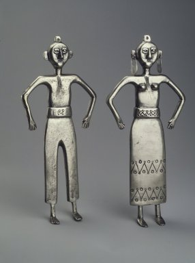 Mapuche. <em>Two Figurines, Male and Female</em>, 19th century. Silver, a: 7 7/8 x 3 1/2 x 11/16 in. (20 x 8.9 x 1.7 cm). Brooklyn Museum, Museum Expedition 1941, Frank L. Babbott Fund, 41.1274.9a-b. Creative Commons-BY (Photo: Brooklyn Museum, 41.1274.9.jpg)