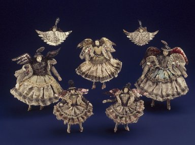 <em>Collection of Briscada Angels and Doll Heads with Wings</em>. Metal:  Silver, tinsel, wire, cloth, hair, shell, .1: 6 x 5 1/4 x 1/2 in. Brooklyn Museum, Museum Expedition 1941, Frank L. Babbott Fund, 41.1275.250a. Creative Commons-BY (Photo: Brooklyn Museum, 41.1275.250a-l.jpg)