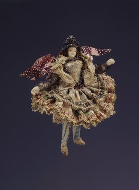 <em>One of a Collection of Briscada Angels and Doll Heads with Wings</em>. Metal; silver tinsel, wire, cloth, hair, shell Brooklyn Museum, Museum Expedition 1941, Frank L. Babbott Fund, 41.1275.250e. Creative Commons-BY (Photo: Brooklyn Museum, 41.1275.250e_SL4.jpg)