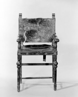 <em>Armchair</em>, 18th century. Spanish cedar, embossed and painted leather, 47 1/2 x 26 1/4 x 20 1/4in. (120.7 x 66.7 x 51.4cm). Brooklyn Museum, Museum Expedition 1941, Frank L. Babbott Fund, 41.1275.25. Creative Commons-BY (Photo: Brooklyn Museum, 41.1275.25a_bw.jpg)