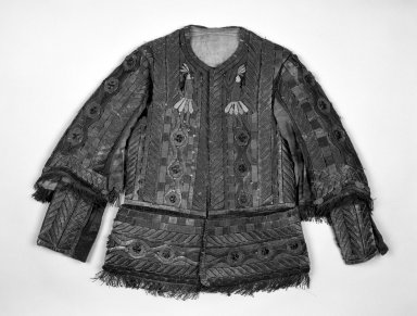 <em>Jacket from Man's Festival Costume</em>, 19th century. Cotton, velvet, bark strips, metallic threads and beads, 32 x 3 x 27 1/2 in. (81.3 x 7.6 x 69.9 cm). Brooklyn Museum, Museum Expedition 1941, Frank L. Babbott Fund, 41.1275.274a. Creative Commons-BY (Photo: Brooklyn Museum, 41.1275.274a_front_bw.jpg)