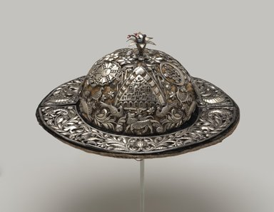 Possibly Aymara. <em>Festival Hat</em>, 18th century. Repoussé silver plaques on velvet, glass beads, wire, 4 15/16 x 13 1/4 x 13 1/4 in. (12.5 x 33.7 x 33.7 cm). Brooklyn Museum, Museum Expedition 1941, Frank L. Babbott Fund, 41.1275.274c. Creative Commons-BY (Photo: Brooklyn Museum, 41.1275.274c_PS9.jpg)