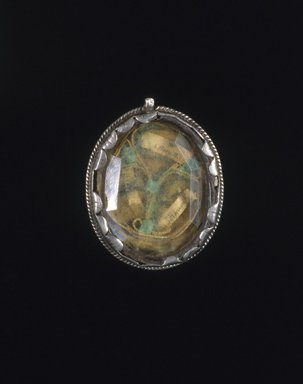 "Unknown. <em>Reliquary Locket</em>, 18th-19th century. ""Relics,"" hair, and bone on cloth background in silver frame with glass lenses, 1 7/8 x 1 3/8 x 1/2 in. (4.8 x 3.5 x 1.3 cm). Brooklyn Museum, Museum Expedition 1941, Frank L. Babbott Fund, 41.1275.383. Creative Commons-BY (Photo: Brooklyn Museum, 41.1275.383_recto_SL1.jpg)"