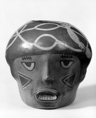 Nazca. <em>Vessel in Form of a Trophy Head</em>, 200-600. Ceramic, pigment, 8 1/16 x 8 7/16 in. (20.5 x 21.5 cm). Brooklyn Museum, Museum Expedition 1941, Frank L. Babbott Fund, 41.1275.42. Creative Commons-BY (Photo: Brooklyn Museum, 41.1275.42_bw.jpg)