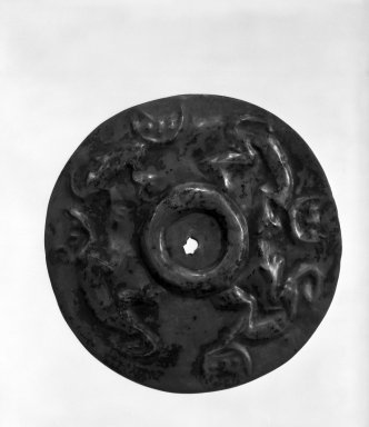 Chimú. <em>Circular Gorget in Form of a Flat Disc</em>, 1000-1400. Silver, 3 9/16 x 3 9/16 in. (9 x 9 cm). Brooklyn Museum, Henry L. Batterman Fund, 41.13. Creative Commons-BY (Photo: Brooklyn Museum, 41.13_bw.jpg)
