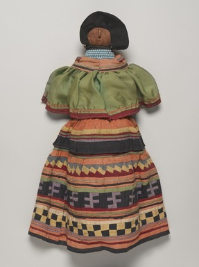 Seminole. <em>Doll Wearing Seminole Woman's Outfit</em>, ca. 1940. Cotton, palmetto fiber, silk, beads, paper, 20 1/2 × 11 × 5 3/16 in. (52.1 × 27.9 × 13.2 cm). Brooklyn Museum, A. Augustus Healy Fund, 41.222. Creative Commons-BY (Photo: , 41.222_PS9.jpg)