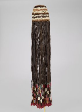 Coastal Wari. <em>Wig Headdress</em>, 600-1000 C.E. Cotton, camelid fiber, human hair, bast fiber, 35 13/16 x 8 3/4 x 2 1/2 in. (91 x 22.2 x 6.4 cm). Brooklyn Museum, Henry L. Batterman Fund, 41.427. Creative Commons-BY (Photo: Brooklyn Museum, 41.427_PS6.jpg)