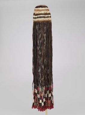 Coastal Wari. <em>Wig Headdress</em>, 600-1000 C.E. Cotton, camelid fiber, human hair, bast fiber, 35 13/16 x 8 3/4 x 2 1/2 in. (91 x 22.2 x 6.4 cm). Brooklyn Museum, Henry L. Batterman Fund, 41.427. Creative Commons-BY (Photo: Brooklyn Museum, 41.427_PS6.jpg)
