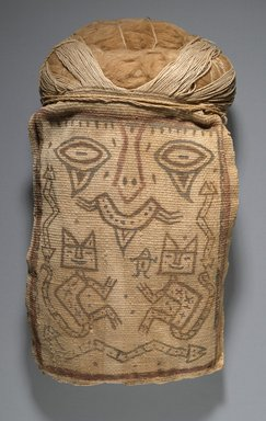 Paracas Ocucaje. <em>False Head for Burial Bundle or Mummy Mask</em>, 100 B.C.E. - 1 C.E. Cotton, pigments, 13 1/2 x 7 1/4 x 3 in. (34.3 x 18.4 x 7.6 cm). Brooklyn Museum, Henry L. Batterman Fund, 41.428. Creative Commons-BY (Photo: Brooklyn Museum, 41.428_PS6.jpg)