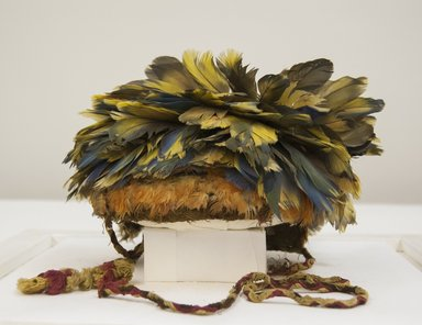 <em>Hat or Headdress</em>, 1440-1532. Cotton, camelid fiber, feathers, 8 1/4 x 9 7/16 in. (21 x 24 cm). Brooklyn Museum, Henry L. Batterman Fund, 41.520. Creative Commons-BY (Photo: Brooklyn Museum, 41.520_front_PS5.jpg)