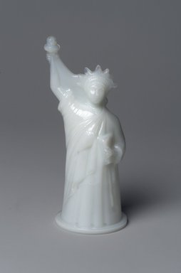American. <em>Figure,  Statue of Liberty</em>, late 19th century. Glass, Overall: 6 x 2 3/4 x 2 3/8 in. (15.2 x 7 x 6 cm). Brooklyn Museum, Gift of Robert J. Kuhn, 41.697. Creative Commons-BY (Photo: Brooklyn Museum, 41.697.jpg)