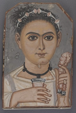 Brooklyn Painter (active Fayum, Egypt, A.D. 200-A.D.250). <em>Boy with a Floral Garland in His Hair</em>, ca. 200-230 C.E. Wood (European linden - Tilia europaea, lime), tempera, 11 3/4 x 7 13/16 x 3/8 in. (29.9 x 19.8 x 0.9 cm). Brooklyn Museum, Charles Edwin Wilbour Fund, 41.848 (Photo: , 41.848_PS9.jpg)