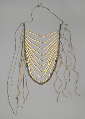 Crow. <em>Man's Breastplate</em>, 1880-1900. Shell, glass beads, commercial leather, brass, twine, 18 1/2 x 11 7/16 in. (47 x 29.1 cm). Brooklyn Museum, By exchange, 41.863. Creative Commons-BY (Photo: Brooklyn Museum, 41.863_PS2.jpg)